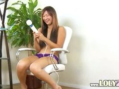oriental with huge big sex-toy in act