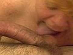 This aged redhead gives a lengthy hawt blowjob. Sucking and licking cock and working his balls hard until that guy shoots his hawt load of cum.