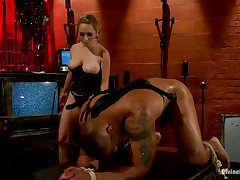 Aiden Starr is punishing Robert Axel for masturbating to her pictures without permission. That babe attaches 15 clothespins to his balls (he guessed 10 when asked). Then she mounts him from behind and pounds his ass with her big dildo. After she fucks him a bit, she receives off and pulls on the clothespins.