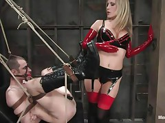 See this super sexy blonde mama teaching this bad boy a lesson in hard way. This babe tied him up and gagged his face hole before fucking his world upside down! This babe puts on a strap on and fucks him real hard. This babe also locked his cock so that he can't cum! This babe keeps teasing his cock and fucking his wazoo with pleasure!