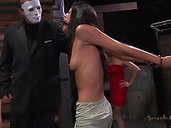 A effortless yet efficient metal device keeps her neck and arms immobilized. This pretty brunette is about to have one hell of an experienced and she's scared. Masked guys put her in a cage and makes her see how a black hunk deepthroats roughly another sexy ass brunette. She got the idea that she's next
