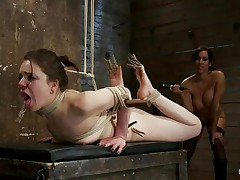 Brunette hair chick with pretty face and sexy ass is getting whipped by this playgirl with big tits. She has laundry pliers on her toes and tongue and it looks like that babe enjoys the pain. After whipping her that babe begins fisting her oiled cunt 1st with one hand and then with both of them. Her snatch barely takes it but that babe has to endure her treatment because she's tied up actually good. When that babe finishes using her hands and a vibrator to fuck that pussy, the breasty playgirl begins to untie her, what's going to happen next?