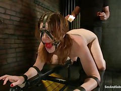 Cici Rhodes likes the dungeon. Belted to a board, tied and gagged the brunette receives a punishment with hot wax and spanking. Her master removes a metal plug from her ass, then re-inserts it, attaching a rope from it to her head. A vibrator runs over her pussy, making her want to cum, but can't yet.