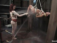 That girl needs an intensive washing and some spanking too and this mistress knows how to do the job right! That babe hanged her and washed her fit sexy body until she putted down, fastened her with another rope and secured her in a ideal position. Are u thinking for what is that dildo in the wall?