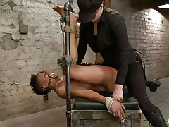With her feet fastened up and metal clamps all over her body the swarthy whore endures a harsh punishment. This goddess knows what he's doing and gives her one as well as the other pain and pleasure. She can't even scream as her throat is folded with scotch tape. Look at that shaved cunt and how deep she's rubbing it with the vibrator.