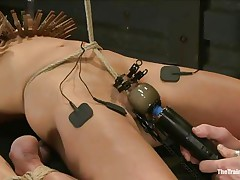 The man is showing his skills in domination and punishment. This man putted laundry pliers on this slut's boobs and then suckers on her teats in advance of rubbing her clit with a vibrator. After rubbing that fur pie worthy and good this man hangs her and probably has something very special for her ass, would you like to see that?