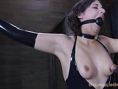 Brunette Marina wearing a dark latex suit and having a large dark ball gagging her mouth is about to be punished by her executor. The man starts with her zeppelins and uses very large suckers to torture 'em and when Marine's nipples are hard he ties 'em with rubber bands. Appears to be that babe will stay there for a long time