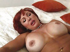 Her years of experience in fucking have a lot to say. Check out this gorgeous redhead milf and how lustfully this hottie sucks and copulates cock. Damn the bitch knows how to swallow a penis and when this hottie goes on top and rides this chap we can clearly watch her pussy lips spreading. Yep this milf needs some jizz deep inside her