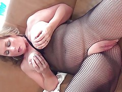 This sexy mature bitch with big round tits is sitting on the bed wearing hose and she is playing with her boobs. She begins rubbing her large shaved pussy becoming very horny. The blonde takes now a lengthy sex-toy and begins riding it waiting the big agonorgasmos coming soon.