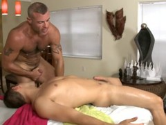 Cute homosexual guy is given a lusty spooning during massage