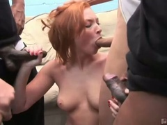 Red head doxy vixen vogel sucks down large hard rods