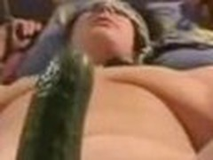 Fastened up wife getting screwed with a big cucumber