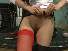 Hawt cutie with red nylons in her fur pie doing messy things with her sex toy