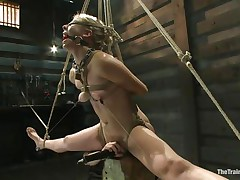 Chastity Lynn is a blonde milf who enjoys being fastened up with ropes. She likes when that babe is not able to move her hands and feet freely. As that babe stands helpless with a ball gag in her face hole and a rope blindfold on her eyes, a friend is giving her a large time pleasure, rubbing her vagina with a vibrator.