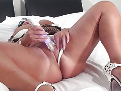 Cindy may not have a gorgeous face but she surely compensates with her huge boobs. This plump bitch desires a schlong in her cunt and throat as she puts the sex tool betwixt her jugs and sucks it then uses it to masturbate.