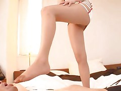 With a pair of smokin' hawt legs like that what man wouldn't want to be at her feet. Akiho is a 29 yo Japanese angel that has a feet fetish. This babe likes dressing on a hose and rubs cock with her feet. This babe puts some pressure on that weenie and looks at it with pleasure. will she get some cream on her thighs?