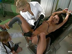 A hot brunette hair is laid on the gynecologist table and the blond doc with the help of her kinky helper gapes the brunette's pussy so she can look closely inside that vagina. It appears to be that the slut enjoys the view and things are beginning to get hot between these three milfs, wanna watch the rest of it?