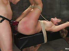 That anal plug conducts electricity straight to her rectum and the sex toy the sexy brunette uses gives her even more pleasure as she drills her vagina with it. Look at her all bound up on that table with her nice ass red from a lot of slapping. That babe screams and moans in that vault but her screaming solely excites her mistress.