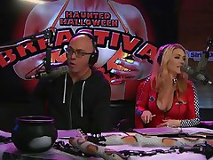 On Playboy Radio's Morning Show, three dressed-up hotties are racing against the clock to make a ghost costume. The in-studio guest is acting as a judge as well but the angels are having trouble. The male host goes to help and the winner is the short cutie who cut out breast holes in her sheet.