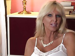 mature whores from usa are known to be hot and naughty. Here we have Tia Gunn, a blonde bitch with giant milk shakes and a lewd face that can give any fellow an erection. She takes out her melons after a short talk and taunts us with 'em by squeezing 'em hard. Do u think this babe merits a cock between her breasts and some semen?