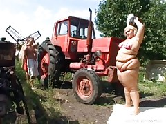 Melinda is so much woman she needs 2 men to fuck her. Tibor and Gabor lift up her chubby folds and widen her ass cheeks. The both engulf on her huge melons outside by the tractor. The rubs each part of her big chubby marvelous body.