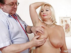 This golden-haired floozy is completely naked at the doctor. The doctor begins examining her big breasts with big and sexy nipples. After that that guy takes her pulse. The aged babes is sitting on the bed now with her big a-hole at the doctor. That guy start inspects her a-hole and big bald cookie from behind.