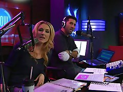 The hosts of Playboy Radio's Morning Show are looking at their guest model who is wearing the suit she'll be wearing to the Playboy Mansion for Halloween. Her head and tits are overspread in fake fruit like oranges, limes, lemons, and more. She flashes her breasts for the hosts and viewers.