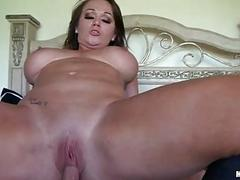 Sensual brunette milf with large balloons rides hard weiner in bedroom