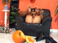 She crushes a pumpkin with her feet