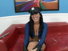 Breasty cop in boots and low cut top sucks cock