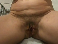 Ever wonder what an old hairy pussy looks like spread wide open?  Well now u don't have to wonder as this hottie shows her loose hanging lips pulled apart for everybody to see inside her cunt.  If you're into big loose pussy lips, this one is for u as this video is all pussy, all open. The only thing missing is he asshole.