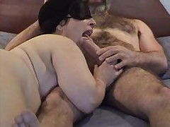 Masked chubby mature wife gives good sucking and licking  to her bushy hubby\'s large dick - short but enjoyable