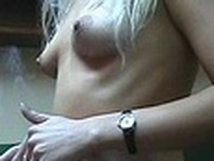 Lecherous blond sweetheart with petite sticking tits walks naked in her room filmed by her boy-friend with dilettante cam in his hands. This guy doesn't like her smoking but really enjoys her hot nude body shyly overspread by Fresh Year tree decoration :)