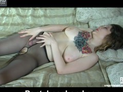 Tattooed playgirl clad in crotchless barely black hose fucking a rubber dong