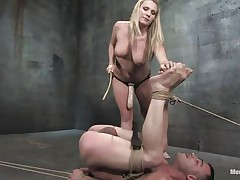 The dominating blonde milf wishes the man's cock but this babe wishes to fuck his wazoo even more! After tieing him with his legs up this babe sucks his cock and plays with his tight shaved anus before inserting a massive strap on sex tool in it. He groans as the sex tool goes unfathomable in his rectum and has to obey in front of the breasty blonde