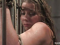 After he tied her on the bars and gave her body a good showering the executor thinks that it's time for a baths so he chained her and putted her sexy body completely beneath water allowing her to breath only through a tube. She 's tied and the dude has complete control over her so why not finger her cunt too.