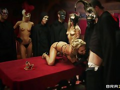 Watch Devon, the golden-haired breasty whore getting served in the dining table to please these guests at the party. The fetish guest, wearing masks getting amused by looking at her wet body full of curves. They played with her bog boobs and then shoved their hard rods unfathomable in her throat to get some admirable blowjob!