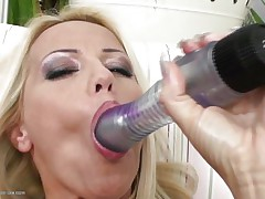 Blond milf wearing merely a couple of hawt darksome nylons is playing solo with her large dildo, that babe sucks it and the fills her shaved vagina with it, fucking herself as hard as that babe can but that is not enough. Luckily her dark brown girlfriend is ready to aid and gives her a hand, rubbing her muff and then fingering it, want to see what else she's ready to do?