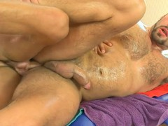 Hairy man acquires a lusty anal spooning from masseur