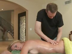 Sizzling Brynn Tyler receives a relaxing rub down
