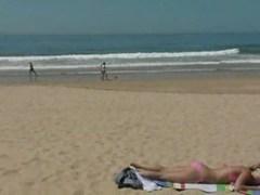 Cutie masturbating at the beach