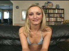 Skinny blonde in a bikini sucks a big black cock
