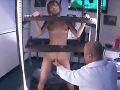 Asian Girl Standing In A Cage Stimulated And Drilled With Toys Getting Her Hairy Pussy Licked By Man In The Lab