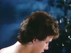Juvenile horny couple in a classic porn movie scene