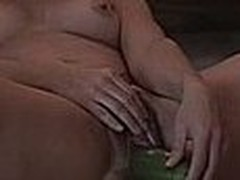 Girl laying on the ground and stuffing her hairy cunt with a large cucumber, this babe can't stop smiling too, this babe just likes making non-professional masturbation videos.
