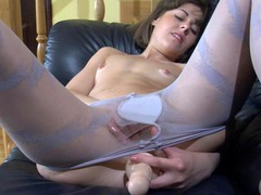 Wicked girlie in blue spiral pattern pantyhose stuffing her itchy slit hole