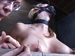 Look at this fucking cheap whore, probably that babe was waiting for some old fashioned arse whipping and throat fucking. Maybe that babe will acquire some of that later but now, the busty sex slave is going to experience smth more intense. With precision and skill they tie her nipples and fingers with wire, want to know why?