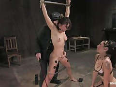 Vai is a hot brown haired milf who enjoys having electrodes all over her body whilst this hottie is tied up with bondage devices. That honey likewise has a ball gag in her mouth, because they know this hottie is a screamer. That honey has a big time joy when Princess Donna Dolore takes a vibrator and begins rubbing on that hairless pussy.