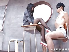 Brunette hair teacher loves treating her bad students with her feet. She got this one tied on a chair, blindfolded him and rubbed his schlong with her feet. The treatment she gives him will surely make him a better student and perhaps he will repay her with a deep hard fuck.
