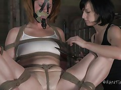 This is how these girls like to play. Cici is all tied up and has a mask on her face while her brunette girl takes advantage of her body. That babe squeezes her nipples and tongue and then begins rubbing that enjoyable cum-hole with a vibrator.